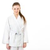 Barn kvinna i karatekimono Arkivbilder