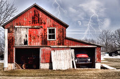 Barn in a lightening storm Royalty Free Stock Image