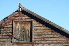 Barn Loft & Pulley. The loft of an historic weatherboard barn/stable that was relocated to higher ground when Old Cromwell town was flooded for Clyde Hydro Royalty Free Stock Photo