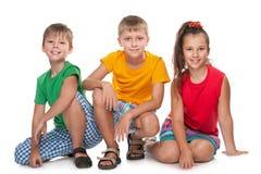 barn lyckliga tre arkivfoton
