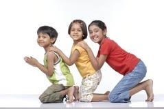 barn lyckliga tre Arkivbild