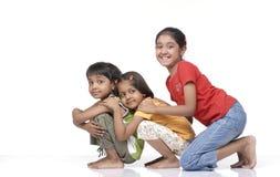 barn lyckliga tre Arkivbilder
