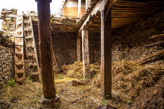 Barn made of stones and wood Stock Images