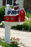 Barn Mailbox. Red and white festive barn mailbox Royalty Free Stock Photo