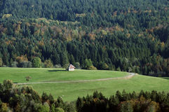 Barn, meadow and forest in autumn Royalty Free Stock Photo