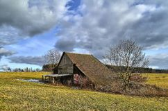 Barn in the meadows. Old barn in the meadows in the February time Stock Photography