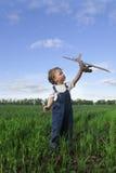 Barn med airplan Royaltyfri Fotografi