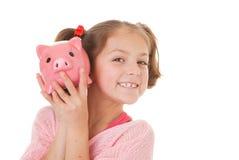 Barn med besparingar royaltyfria bilder