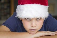 Barn med den Jultomte hatten Arkivbild