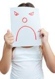 Barn med en paper maskering med en ilsken framsida Arkivbild