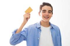 Barn med kreditkorten royaltyfri fotografi