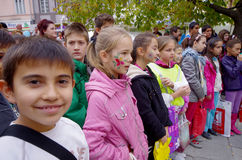 Barn med målade framsidor Fotografering för Bildbyråer