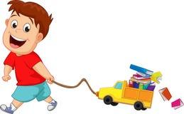 Barn med många böcker och leksakbilar Royaltyfria Bilder