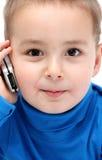 Barn med mobiltelefonen Royaltyfria Foton