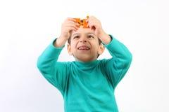 Barn med pusslet Arkivbilder