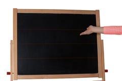 Barn med svart tavlabarns hand som klippt Arkivfoton