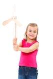 Barn med väderkvarnleksaken arkivbild