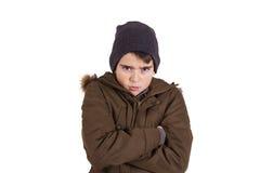 Barn med vinterkläder som isoleras på vit arkivfoton