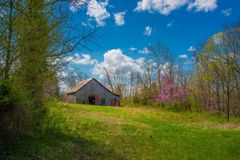 Barn in the midwest. Barn midwest old primitive wood sky landscape farm clouds blue farming agriculture wooden stock photos