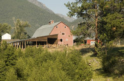Barn in Montana mountains. Scenic view of barn building in mountainous Montana rural landscape, U.S.A royalty free stock photos