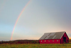 Barn N Rainbow. Fall thunderstorm sets up a colorful scene in rural iowa. Between the trees, barn, and a setting sun royalty free stock image