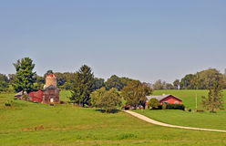 Barn near Madison, Wisconsin. Red barn and house on family farm in Wisconsin Royalty Free Stock Images