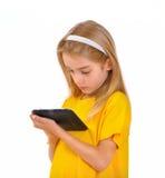 Barn och e-bok Arkivbilder