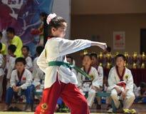 Barn och härlig konkurrent--Den sjunde konkurrensen för GoldenTeam koppTaekwondo vänskapsmatch Fotografering för Bildbyråer