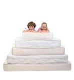 Barn och många madrasser Royaltyfri Foto