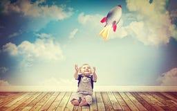 Barn- och raketleksak Arkivbild