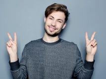 Barn och stilig affärsman som pekar upp med hans finger fotografering för bildbyråer