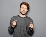 Barn och stilig affärsman som pekar upp med hans finger royaltyfri foto