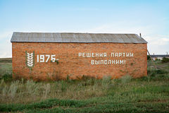 The barn with old soviet slogan. The decrees of Party would make royalty free stock photography