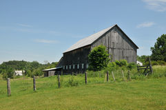 Barn. Old weathered wooden barn in a field near Stowe, Vermont stock photo