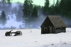 Barn and old wooden wagon in the snow Royalty Free Stock Image