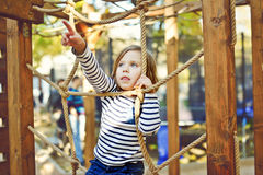 Barn på lekplatsen Fotografering för Bildbyråer