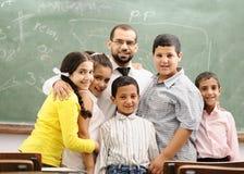 Barn på skolaklassrumet royaltyfria foton