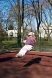 Barn på swing   royaltyfri foto