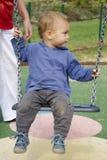 Barn på swing Arkivfoton