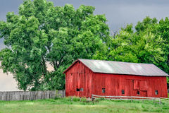 Barn Pasutre Tree (fused). An old red barn in country stock images