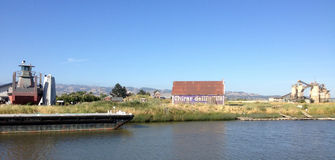 Barn on the Petaluma River, California. PETALUMA, CALIFORNIA - MAY 5, 2013 -- A barn with a Ghirardelli advertisement remains enshrined in history along the Royalty Free Stock Images