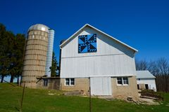Barn Quilt Pattern. This is a Spring picture of a quilt pattern titled Indian Trail on a barn located in Racine, Wisconsin. This pattern was painted in 2008 by stock photos