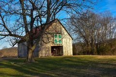Barn Quilt in the Winter Sun. Barn Quilt Square on barn at Seven Islands Birding Park in Tennessee royalty free stock photo