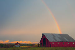 Barn With Rainbow. Red Barn and a rainbow royalty free stock photos