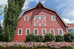 Barn. Red barn with flowers in front Royalty Free Stock Photography