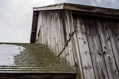 Barn roofline with snow stock photo