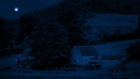 Barn in rural area at night. Barn in the moonlight in countryside stock video