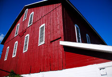 Barn Side. This is a shot of the side of a red barn looking up.Odd numbered Louvre windows add to the character of this barn Stock Images