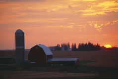 Barn and Silo at sunset Stock Photos