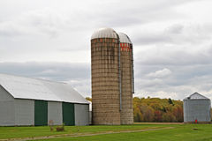Barn with silos on a farm Stock Images